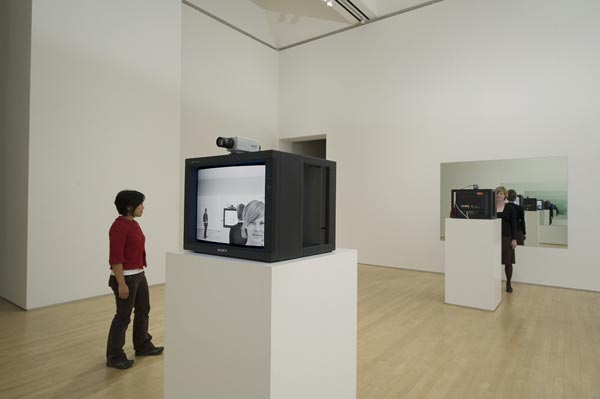 Dan Graham, Opposing Mirrors and Video Monitors on Time Delay, 1974/1993, Collection SFMOMA, Gift of Dare and Themis Michos and Accessions Committee Fund: gift of Collectors Forum, Doris and Donald Fisher, Evelyn and Walter Haas, Jr., Pam and Dick Kramlich, Leanne B. Roberts, Madeleine H. Russell, and Helen and Charles