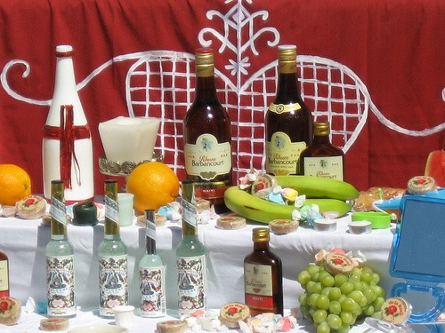 Vodou Altar with Florida Water, Rum, Fresh Fruits and Candies.