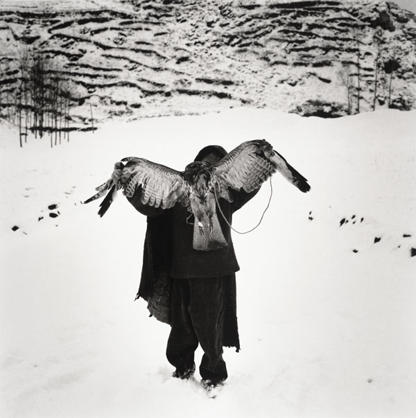 Li Lang, Riha, Zhaojue, Sichuan, China. A boy holding an eagle standing in the snow. From the series The Yi People, 2002. Accessions Committee Fund © Li Lang