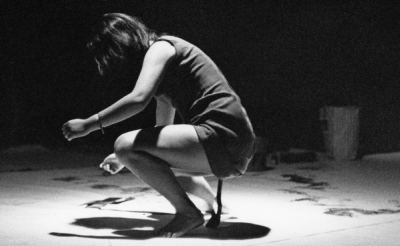 Shigeko Kubota performing her Vagina Painting, July 4th, 1965 at Cinemateque, E 4th Street, New York City during Perpetual Fluxus Festival; photo: George Maciunas; 1965 © George Maciunas Foundation Inc. 2013 All Rights Reserved