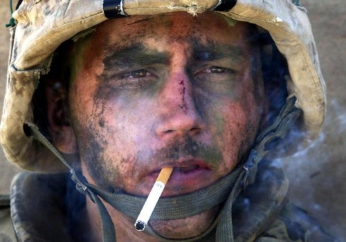"""Marine Lance Cpl. James Blake Miller, 20, of Kentucky, a member of Charlie Company of the U.S. Marines First Division, Eighth regiment, smokes a cigarette. Miller came to be known as the """"Marlboro Man"""" for this iconic photograph from the Iraq War. (Luis Sinco/Los Angeles Times)"""