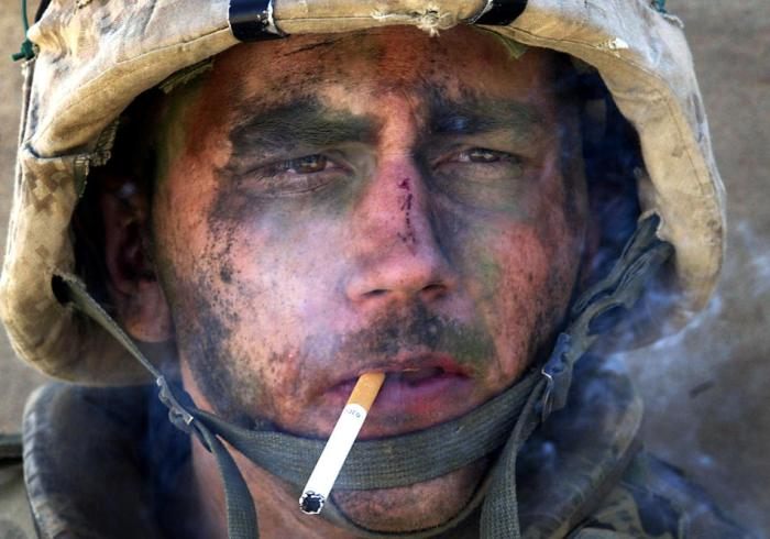 "Marine Lance Cpl. James Blake Miller, 20, of Kentucky, a member of Charlie Company of the U.S. Marines First Division, Eighth regiment, smokes a cigarette. Miller came to be known as the ""Marlboro Man"" for this iconic photograph from the Iraq War. (Luis Sinco/Los Angeles Times)"