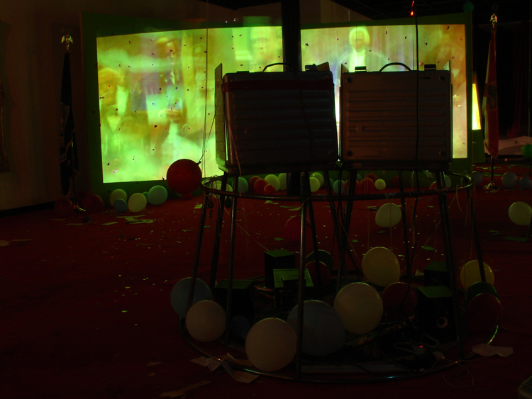Stephen G. Rhodes, Interregnum Restoration Repetition (Who Farted!!??!??!!!?!), 2008; two channel video, mixed media and voting booths, dimensions variable; installation view, Prospect.1 New Orleans, 2008; courtesy the artist and Galerie Isabella Bortolozzi, Berlin