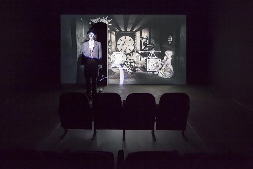 John Bock, Der magische Krug, 2013; animated puppets, canvas, cinema seats; projection: 259 x 485 x 200 cm, cinema seats: 125 x 250 x 250 cm; installation view, John Bock, 'Knick-Falte in der Schädeldecke', Sprüth Magers, Berlin, March 15 - April 12, 2014; © John Bock, courtesy Sprüth Magers